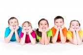 foto of pretty-boy  - Five beautiful smiling kids lying on the floor in bright colorful t - JPG