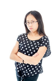 stock photo of tween  - Asian tween girl with folded arms showing displeasure - JPG