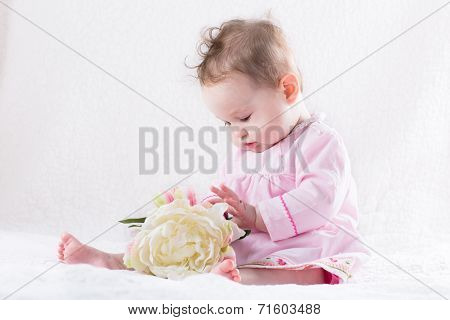 Sweetest Little Baby Girl Playing With A Huge White Flower