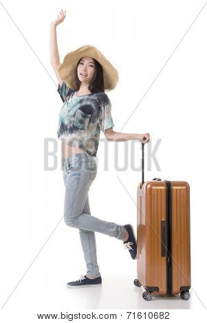 Exciting Asian woman drag a luggage, full length portrait isolated on white background.