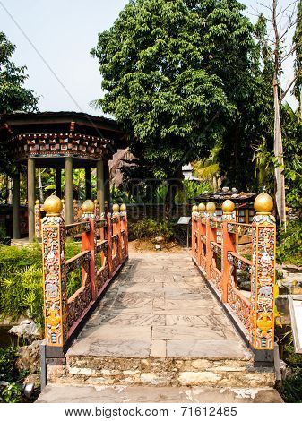 Bhutan Traditional Bridge And Gazebo In Garden