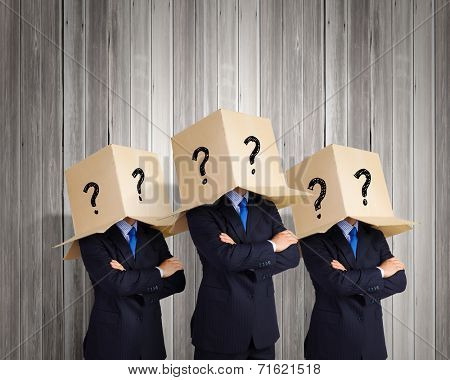 Businessman with box on head expressing emotions