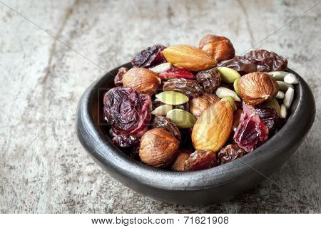 Trail mix in black bowl.  Delicious healthy fruit, nuts and seeds.
