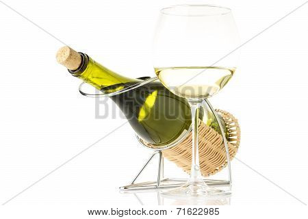 Bottle In Holder With Glass Of White Wine Isolated On White Background