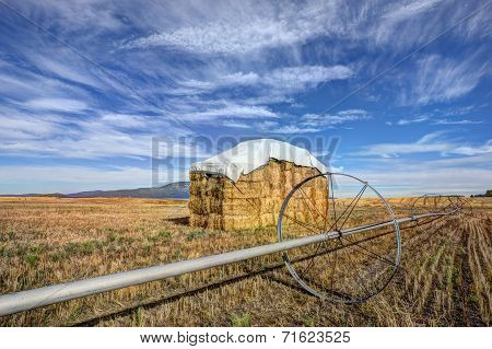 Haystack And Irrigation Pipe.