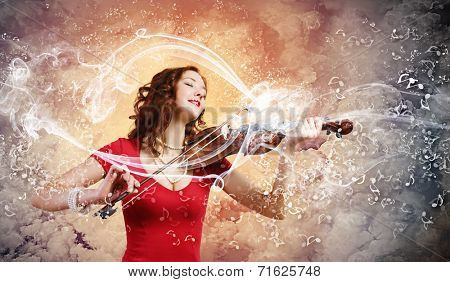 Young attractive woman in red dress playing violin