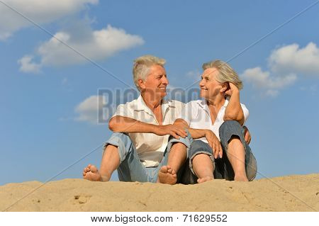 Happy mature couple barefoot