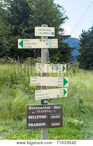 COL DE VOZA, FRANCE - AUGUST 24: Tour du Mont Blanc direction signs. The popular tour goes through France, Italy and Switzerland, and is clearly signalised throughout. August 24, 2014 in Col de Voza.