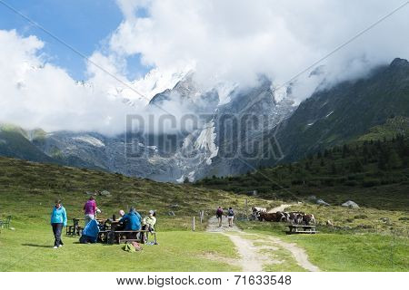 ST-GERVAIS-LES-BAINS, FRANCE - AUGUST 24: Hikers at the Truc Hostel, at bottom of the Domes de Miage mountain. This is one of the stages of the Mont Blanc Tour August 24, 2014 in St-Gervais-les-Bains.