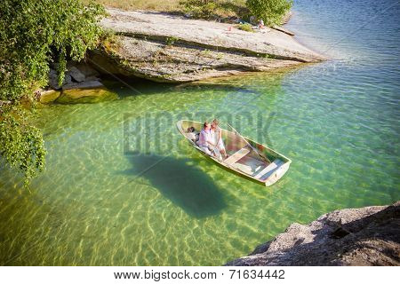 The Top View The Boat In Transparent Water With Couple