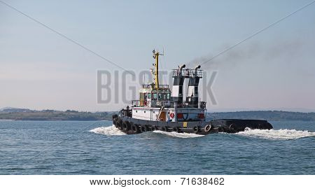 Black Tug Is Underway On Black Sea, Bulgaria