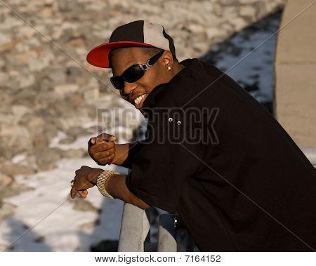 Hip Hop man pointing ahead.