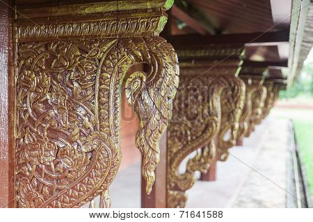 Golden wooden carving buttress in temple