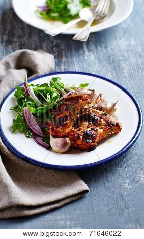 Oven-baked chicken wings with arugula salad