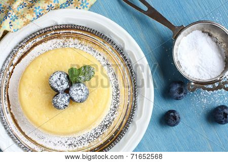 Lemon Surprise Pudding Cake  Served With Berries