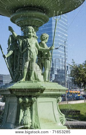 Detail Of Historic Fountain At Bankowy Square In Warsaw .