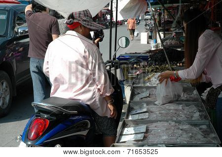 Woman Buying Fresh Seafood