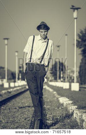 Guy In Balance On A Rail