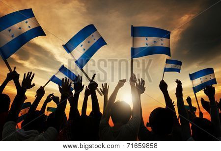 Silhouettes of People Holding Flag of Honduras