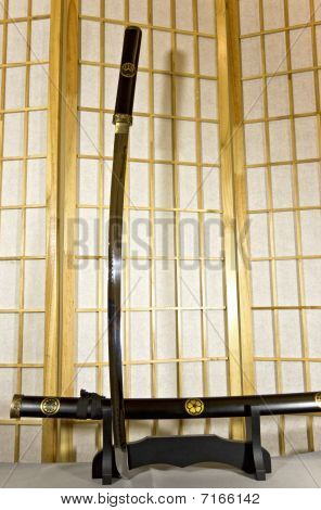 Traditional Japanese samurai sword mounted on special black wooden stand