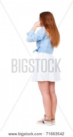 Woman plugs ears with his fingers, not wanting to listen to.  girl  watching. Rear view people collection.  backside view of person.  Isolated over white background.  Girl in office attire stands back