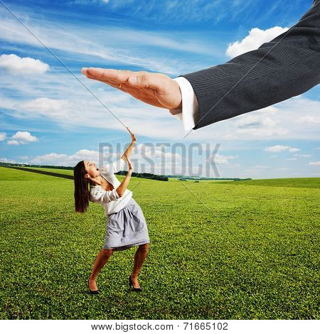 concept photo of conflict between subordinate and boss. frightened businesswoman screaming and looking up at big palm of his boss over at outdoor