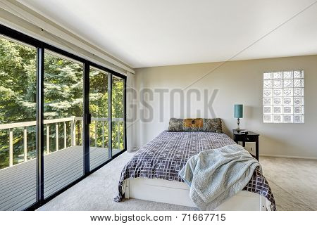 White Refreshing Bedroom Interior With Walkout Deck