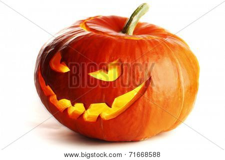 Scary Jack O Lantern halloween pumpkin with candle light inside isolated on white