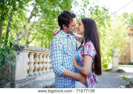Amorous travelers embracing outdoors