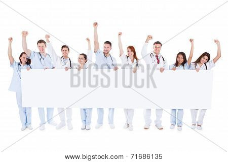 Group Of Healthcare Personnel Holding A Banner