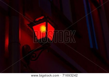 Red lantern on the wall in Red Light District in Amsterdam, Netherlands