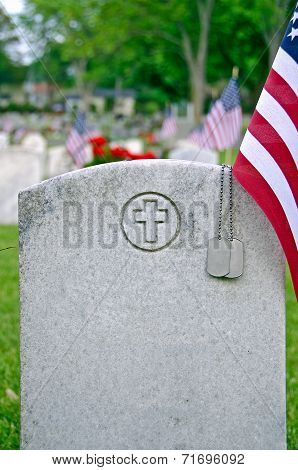 dog tags on veteran's tomb