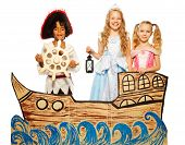 stock photo of sail ship  - Theatrical play boy in costume of pirate and girls in princess dress sail on cardboard ship - JPG