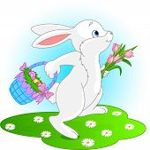 stock photo of easter bunnies  - Illustration of running Easter Bunny with a basket full of eggs and bouquet of flowers - JPG