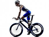 stock photo of triathlon  - man triathlon iron man athlete biker cyclist bicycling biking in silhouette on white background - JPG