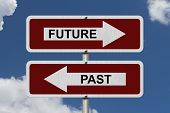 pic of past future  - Future versus Past Red and white street signs with words Future and Past with sky background - JPG