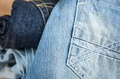 image of jeans skirt  - In the picture we can see blue jeans and their various parts and components and many details - JPG