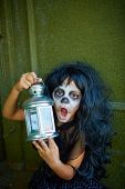 pic of antichrist  - Weird Halloween girl with lantern looking at camera - JPG