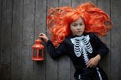 pic of antichrist  - Portrait of cute girl in red wig and with lantern looking at camera - JPG