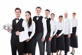 foto of waiter  - Large group of waiters and waitresses standing in row - JPG