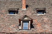 stock photo of sibiu  - sibiu city romania traditional architecture detail roof tile face - JPG