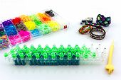 stock photo of loom  - Colorful of elastic rainbow loom on white background - JPG