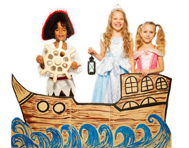 stock photo of pirates  - Theatrical play boy in costume of pirate and girls in princess dress sail on cardboard ship - JPG