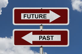 picture of past future  - Future versus Past Red and white street signs with words Future and Past with sky background - JPG