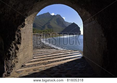 View Of Beach Through Tunnel