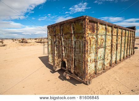 abandoned shipping container in the desert