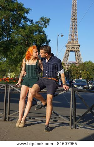 PARIS - SEP 09: young couple dating near Eiffel Tower on September 09, 2014 in Paris, France. Paris, aka City of Love, is a popular travel destination and a major city in Europe