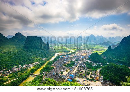 Karst Mountain landscape and village on the Li River in rural Guilin, Guangxi, China.