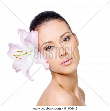 Woman With Lily In Hair