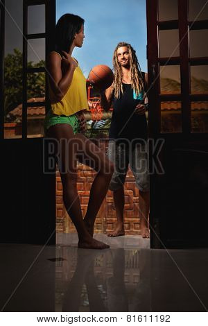 Couple with basket ball at home